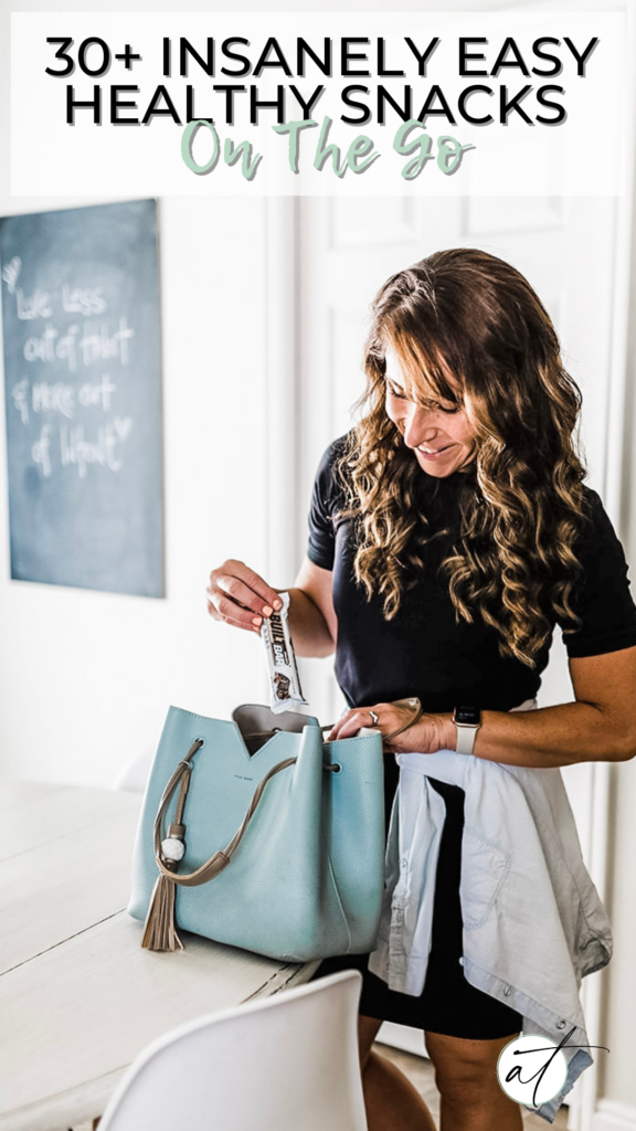 Women packing her purse with healthy snacks to eat on the go